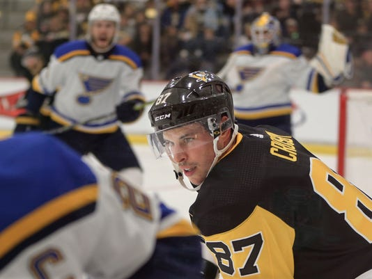 Pittsburgh Penguins' Sidney Crosby (87) chases after St. Louis Blues' Alex Pietrangelo, left, in front of the goal during the first period of the NHL preseason hockey game, Sunday, Sept. 24, 2017, in Cranberry, Pa. The preseason game was awarded to Rostraver Ice Garden, the winner of the 2016-2017 Kraft Hockeyville USA contest, but is being played at the UPMC Lemieux Sports Complex because Rostraver is not suitable for an NHL game. (AP Photo/Keith Srakocic)