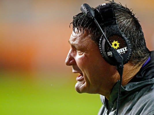LSU  coach Ed Orgeron yells to his players during the second half of an NCAA college football game against Tennessee on Saturday, Nov. 18, 2017, in Knoxville, Tenn. LSU won 30-10. (AP Photo/Wade Payne)
