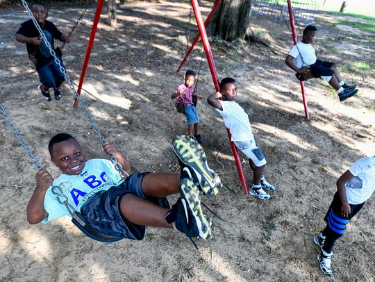 Children play in Diffley Park on Crenshaw Street in