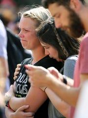 Teddi Shapiro comforts Sarah Elderkin, both University