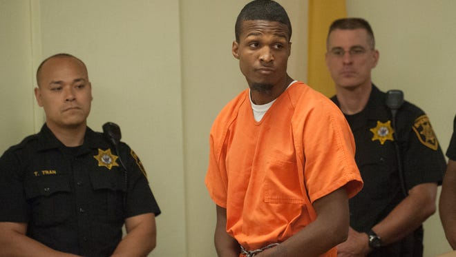 Tashad Henry looks on during a murder arraignment at the Camden County Superior Court in Camden.