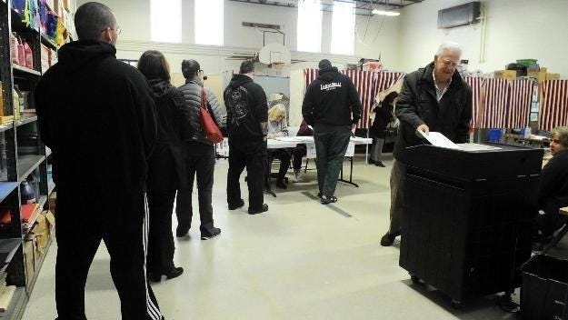 """The """"huge"""" voter turnout occurred because a large percentage of residents opted to mail their ballots to the board of registrars, under a new state law approved by Gov. Charlie Baker."""