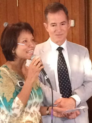 Grover Rees, right, and wife Landai speak to audience this week at campaign kickoff.