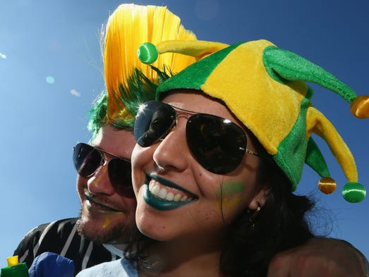 SAO PAULO, BRAZIL - JUNE 12:  Fans of Brazil pose before the Opening Ceremony of the 2014 FIFA World Cup Brazil prior to the Group A match between Brazil and Croatia at Arena de Sao Paulo on June 12, 2014 in Sao Paulo, Brazil.  (Photo by Kevin Cox/Getty Images)