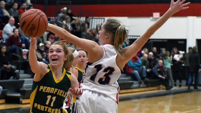 Pennfield's Melanie McIntyre (11) drives the basket during the fourth quarter of play Friday night.