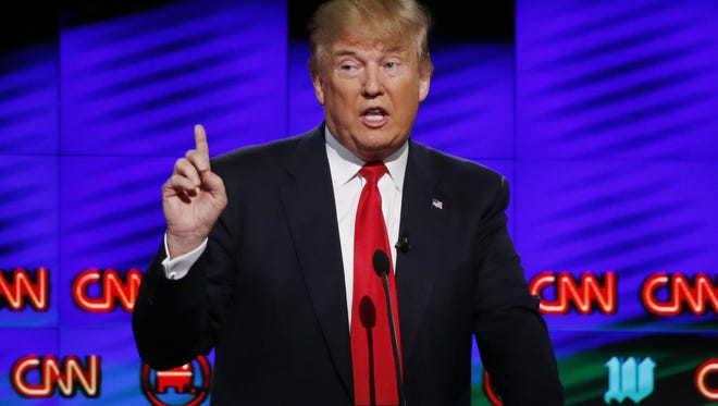 In this March 10, 2016, file photo, Donald Trump, speaks during the Republican debate in Coral Gables, Fla.