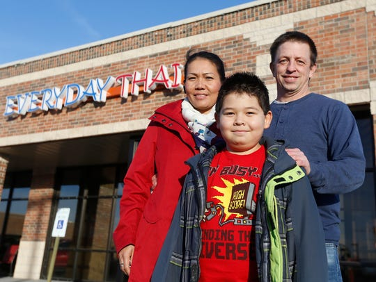 Steven and Thippawan Shutts, along with their son, Arthur Shutts, stand outside their new restaurant, Everyday Thai. They began by running a popular food truck in the Ft. Leonard Wood area that attracted national attention.