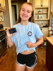 Taylor Robinson, 12, shows her insulin pump sight on