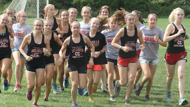 Oak Hills High School's girls cross country team practices together on Aug. 30, 2017.