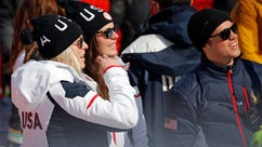 United States' Lindsey Vonn, left, speaks to United States' Breezy Johnson as they stand near the finish area after completing women's downhill training at the 2018 Winter Olympics in Jeongseon, South Korea, Monday, Feb. 19, 2018. (AP Photo/Christophe Ena)