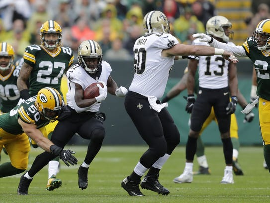 New Orleans Saints running back Alvin Kamara (41) breaks away from Green Bay Packers linebacker Blake Martinez (50) in the first half on Oct. 22, 2017, at Lambeau Field.
