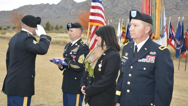 Command. Sgt. Maj. William K. Maddox, center left, accepts a US flag during his retirement ceremony at White Sands Missile Range on Tuesday, Dec. 5, 2017.