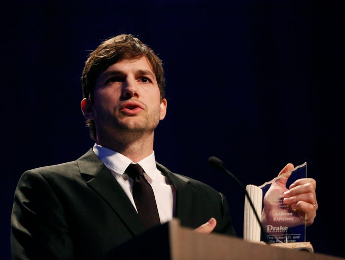 Actor and Iowa native Ashton Kutcher accepts the Robert