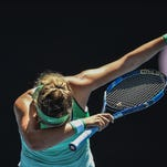Victoria Azarenka of Belarus reacts after defeating Barbora Strycova of the Czech Republic in their fourth round match.