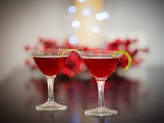 Cherry and pomegranate create an nontraditional holiday drink, Cherry Pomtinis,