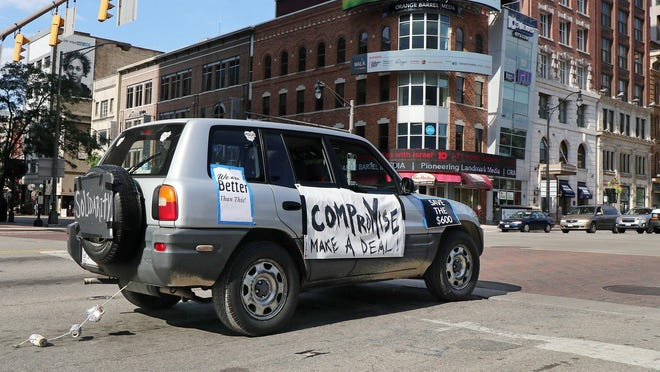 Ohio Families For Covid Relief held a caravan rally around the Statehouse. Participants demonstrated their support for the Heroes Act on Thursday, August 13, 2020. One of the cars eastbound on Broad St. passes High St. during the rally.