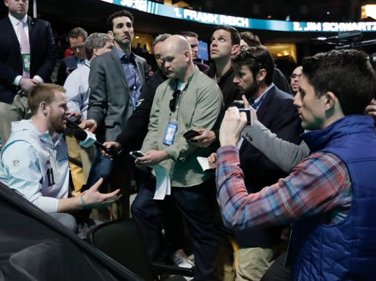 Philadelphia Eagles' Carson Wentz talks to reporters during NFL football Super Bowl 52 Opening Night Monday, Jan. 29, 2018, at the Xcel Center in St. Paul, Minn. (AP Photo/Eric Gay)