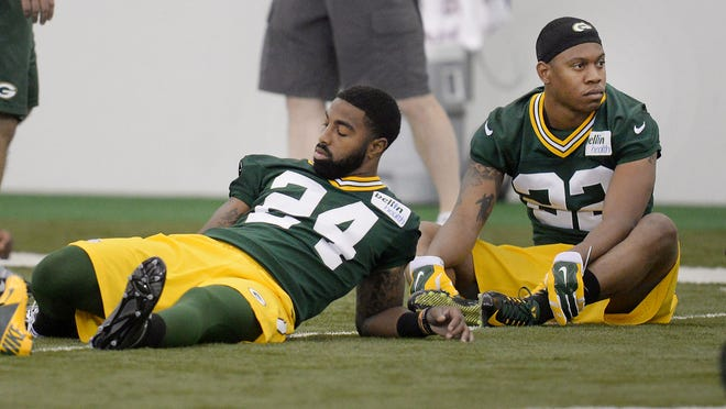 Green Bay Packers rookie Quinten Rollins (24) stretches out next to Anthony Wooding (22) during rookie orientation in the Don Hutson Center.