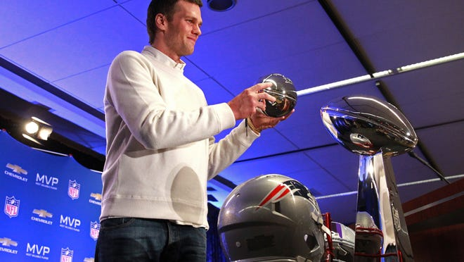 Feb 2, 2015; Phoenix, AZ, USA; New England Patriots quarterback Tom Brady poses with the Pete Rozelle trophy during the Super Bowl XLIX-Winning Head Coach and MVP Press Conference at Media Center-Press Conference Room B. Mandatory Credit: Joe Camporeale-USA TODAY Sports