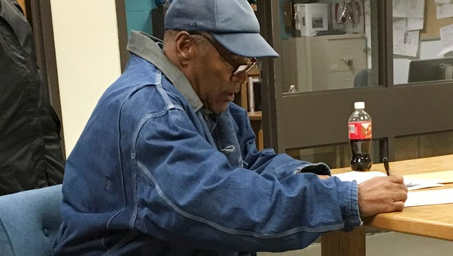 Former football legend O.J. Simpson signs documents at the Lovelock Correctional Center, Saturday, Sept. 30, 2017, in Lovelock, Nev. Simpson was released from the Lovelock Correctional Center in northern Nevada early Sunday, Oct. 1, 2017.