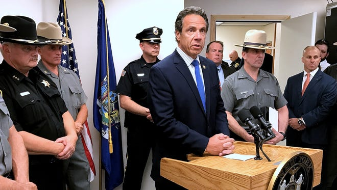 Gov. Andrew Cuomo talks to reporters Monday about the death of state Trooper Nicholas Clark at the state police barracks in Painted Post.