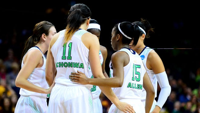 Notre Dame Fighting Irish players huddle against the Robert Morris Colonials in the first half of a women's college basketball game in the first round of the NCAA Tournament at Savage Arena.