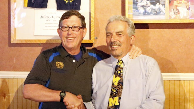 Mike Stephens, left, and Ed Reese after they signed an agreement to pool the resources of the Jeff Reese Foundation and Mark Stephens Foundation on May 15 at Roundin' Third restaurant in Elmira.