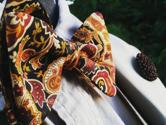 "Harris' ""Autumn"" bow tie and flower lapel pin."