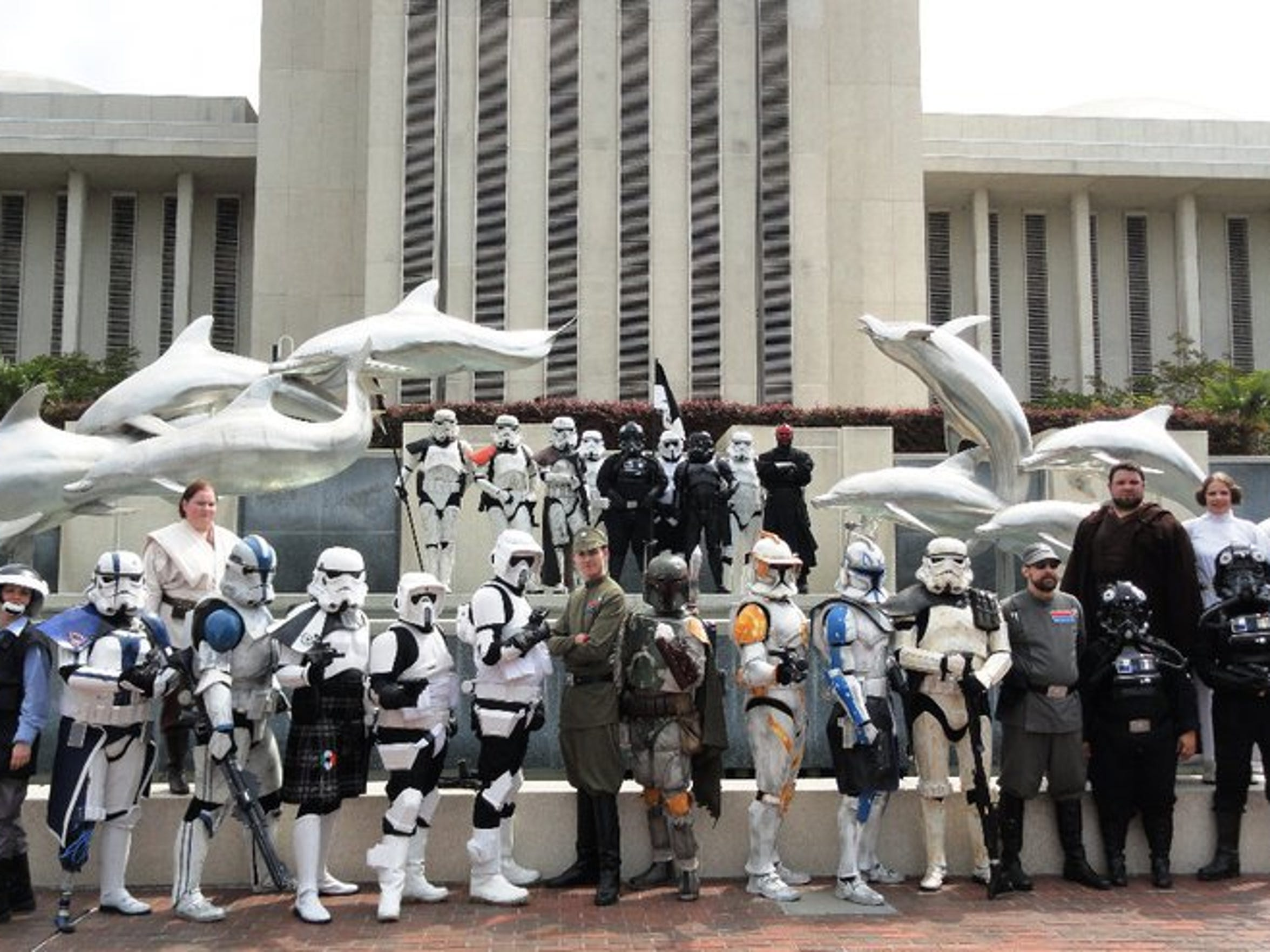 """Members of the 501st Legion, a """"Star Wars"""" costume club, pose behind the Capitol."""