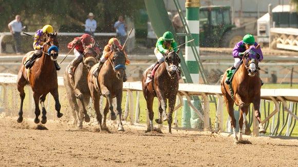 California Chrome and Victor Espinoza, right, are in command in mid-stretch and go on to win the Grade I $1,000,000 Santa Anita Derby Saturday, April 5, 2014 at Santa Anita Park, Arcadia, CA. ©Benoit Photo