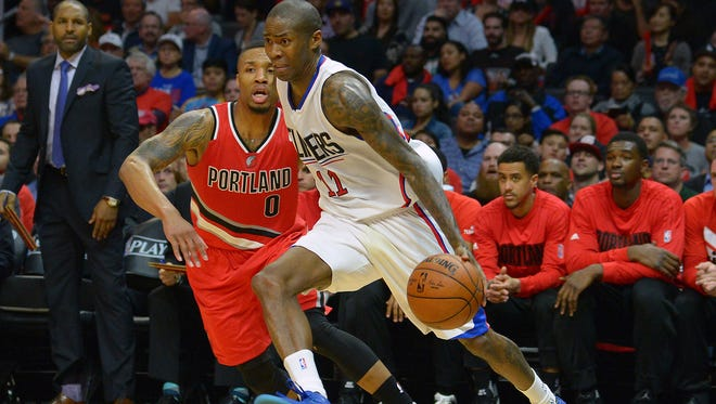 Portland Trail Blazers guard Damian Lillard (0) guards Los Angeles Clippers guard Jamal Crawford (11) as he drives to the basket in their first round playoff series.