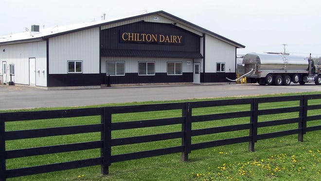 An Ottery Trucking bulk truck loads goat milk at Chilton Dairy in southern Calumet County for delivery to LaClare Farms for processing at the edge of the village of Pipe in northeastern Fond du lac County.