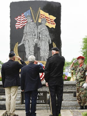A wreath is placed at the base of the Lake George Vietnam War Memorial  in 2016.