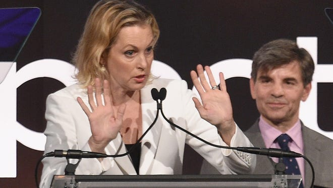 Ali Wentworth (front) speaks onstage during the GLSEN Respect Awards in May while her husband George Stephanopoulos listens.