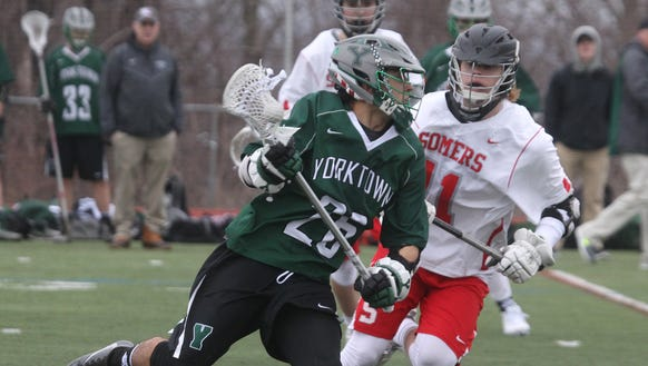 Yorktown's Dom Cioffi runs past Somers' Jack Kessler