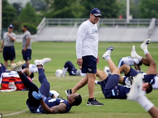 FILE - In this May 26, 2016, file photo, Tennessee Titans coach Mike Mularkey watches as players stretch during NFL football practice in Nashville, Tenn. Titans controlling owner Amy Adams Strunk saw enough of Mularkey as he finished the final nine games last season as interim coach to give him the job after interviewing a handful of coaches in January. Her decision made Mularkey the 16th man hired as a permanent coach of three or more NFL teams since the NFL-AFL merger in 1970. (AP Photo/Mark Humphrey, File)