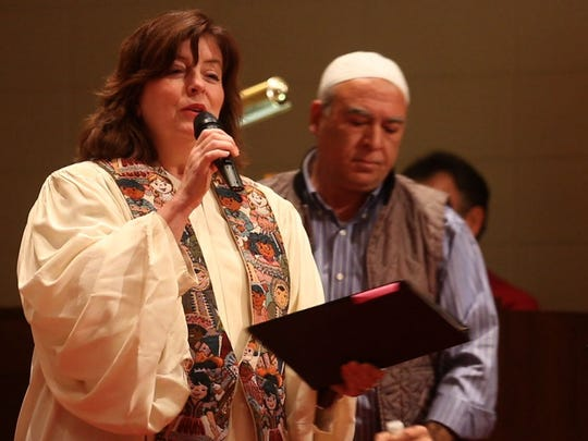 Rev. Diane Ford of the Lincroft Presbyterian Church talks to the people gathered.  The Lincroft Presbyterian Church hosts the Bayshore Ministerium Interfaith Thanksgiving Service with the idea that bringing people of different faiths together will make the world a better place.Lincroft, NJTuesday, November 24, 2015@dhoodhood