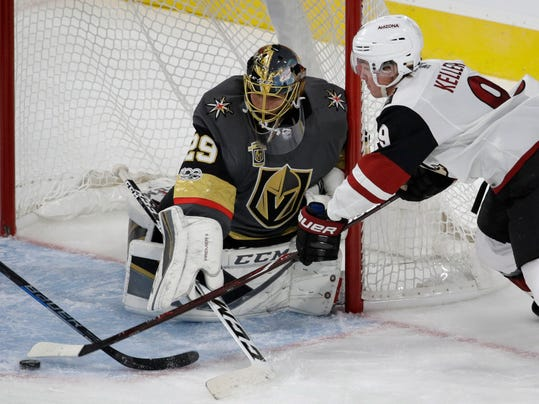 FILE - In this Tuesday, Oct. 10, 2017 file photo, Arizona Coyotes center Clayton Keller attempts to shoot on Vegas Golden Knights goalie Marc-Andre Fleury during the third period of an NHL hockey game in Las Vegas. The Golden Knights have a legitimate chance to surpass the 1993-94 Florida Panthers' mark record for most wins (33) and points (83) by an expansion franchise. It should be pointed out that Florida's mark came in an 84-game season while Vegas will play 82. (AP Photo/John Locher, File)