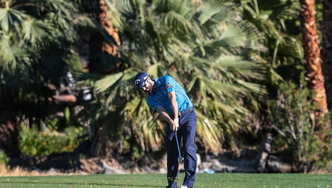 Adam Hadwin hits his approach shot on 18 at the La Quinta Country Club  during the 3rd round of the CareerBuilder Challenge on Saturday, January 21, 2017. He finished the day at 17 under.