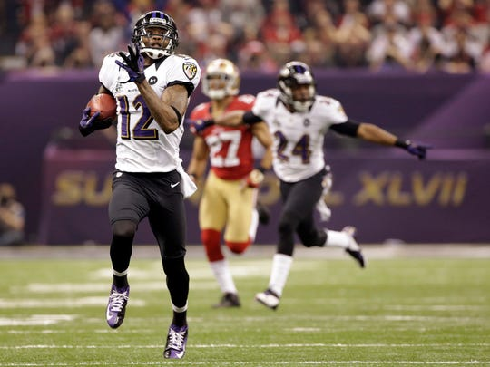 FILE - In this Feb. 3, 2013, file photo, Baltimore Ravens wide receiver Jacoby Jones (12) returns a kickoff over 100-yards for a touchdown during the second half of the NFL Super Bowl XLVII football game against the San Francisco 49ers in New Orleans. Jones will retire as a member of the Ravens on Friday, Sept. 30, 2017, the team for which he played his best football and earned a Super Bowl ring. (AP Photo/Mark Humphrey, File)