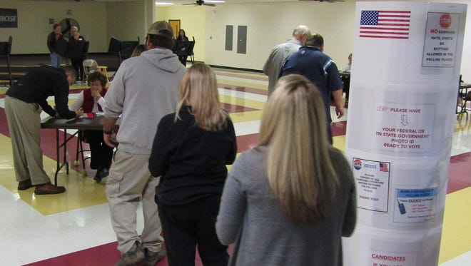 Poll workers assist last-hour voters at the Fairview Recreation Center.