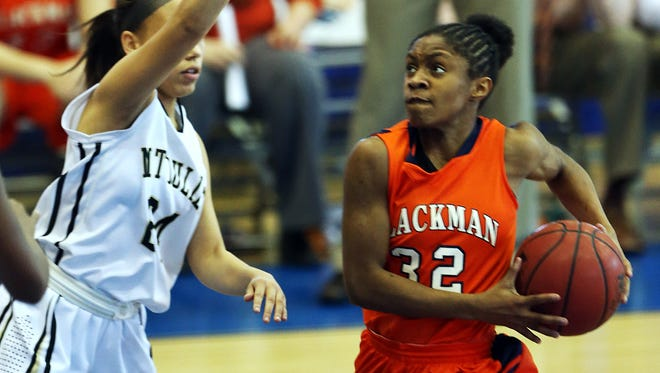 Blackman's Crystal Dangerfield charges to the net against Mt. Juliet's Ashley Roby in the second half during the TSSAA Class AAA state semifinals Friday, March 7, 2014 at MTSU. Blackman won 55-46.