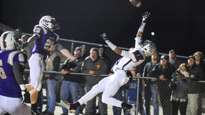 Alcoa's Tykee Kellogg goes up for a pass in the end zone against Sequatchie County on Friday.
