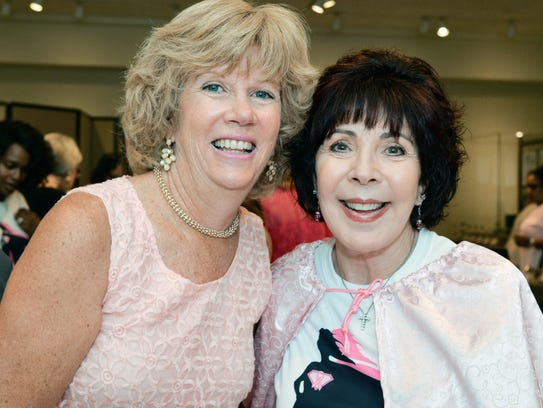 Loretta DiRosa, left, and Karen Miret attend the Friends