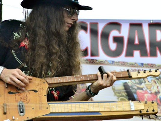 Justin Johnson performs during the 2014 Pennsylvania Cigar Box Guitar Festival at the York Emporium. This year's festival will be from 10 a.m. to 6 p.m. Saturday, Aug. 29.