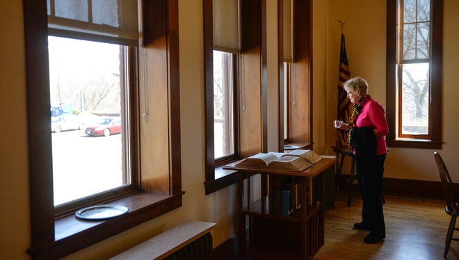 Barbara Ludwig has a look around the historic 1911 classroom Wednesday, April 13, during a reception to celebrate Riverview Hall's inclusion on the National Register of Historic Places at St. Cloud State University.