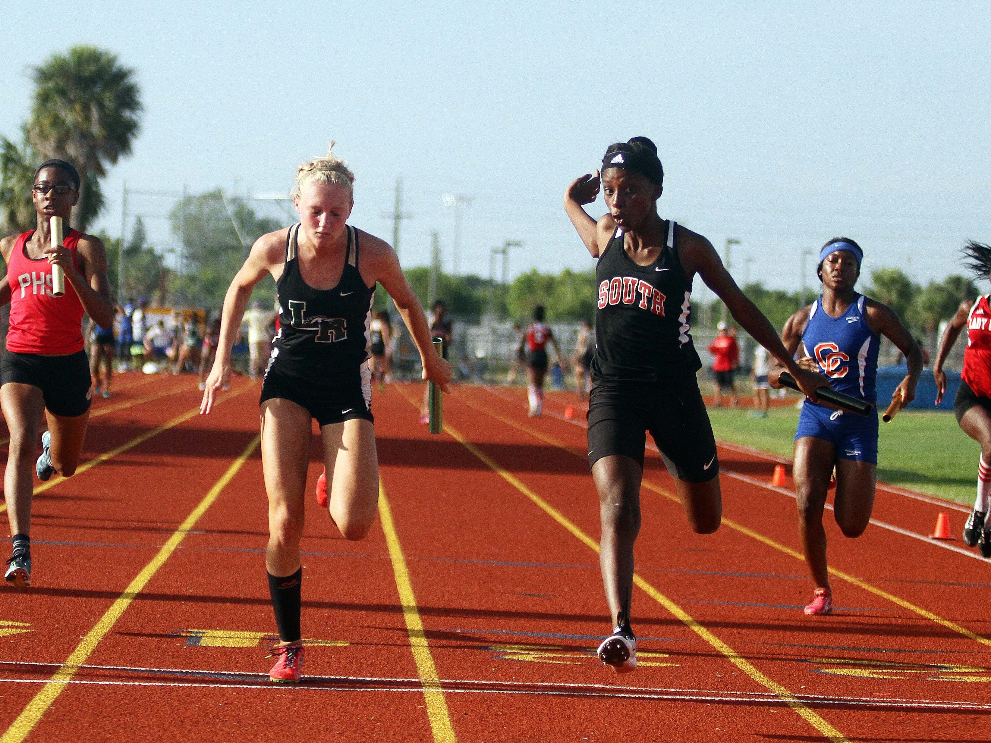 South Fort Myers' Mirlege Castor, center right, edges out Sophia Falco from Lakewood Ranch at the finish of the 400-meter girls relay Thursday at the Region 3A-3 track meet at Charlotte High School.