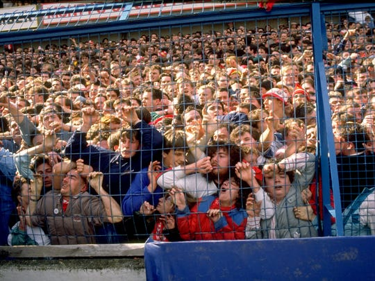 Liverpool supporters are crushed against a barrier at Hillsborough Stadium in Sheffield, England, on April 15, 1989. Ninety-six Liverpool fans died in the crush.