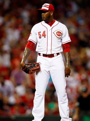 Jul 14, 2015: National League pitcher Aroldis Chapman (54) of the Cincinnati Reds looks for a sign against the American League during the ninth inning of the 2015 MLB All Star Game at Great American Ball Park.