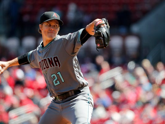 Arizona Diamondbacks starting pitcher Zack Greinke throws during the first inning of a baseball game against the St. Louis Cardinals Saturday, April 7, 2018, in St. Louis. (AP Photo/Jeff Roberson)